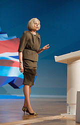Conservative Party Conference, ICC, Birmingham, Great Britain <br /> Day 3<br /> 9th October 2012 <br /> <br /> Theresa May MP<br /> Home Secretary<br /> keynote speech <br /> <br /> <br /> Photograph by Elliott Franks<br /> <br /> United Kingdom<br /> Tel 07802 537 220 <br /> elliott@elliottfranks.com<br /> <br /> ©2012 Elliott Franks<br /> Agency space rates apply
