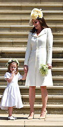 Meghan Markle's mother Doria Ragland, the Prince Charles, Prince of Wales, the Duke of Cambridge, the Duchess of Cornwall and Duchess of Cambridge holds her daughter Princess Charlotte's hand as they leave the wedding ceremony of Prince Harry and Meghan Markle at St George's Chapel, Windsor.