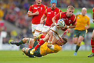 Gareth Ashcombe is tackled during the Rugby World Cup Pool A match between Australia and Wales at Twickenham, Richmond, United Kingdom on 10 October 2015. Photo by Ian Muir.during the Rugby World Cup Pool A match between Australia and Wales at Twickenham, Richmond, United Kingdom on 10 October 2015. Photo by Ian Muir.