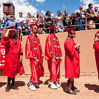 051513       Brian Leddy<br /> University of New Mexico-Gallup graduates wait to receive their degrees at Red Rock Park Wednesday afternoon. The school saw over 400 students receive degrees at this year's graduation.