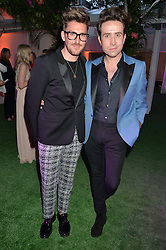 Left to right, HENRY HOLLAND and NICK GRIMSHAW at the Glamour Women of The Year Awards in Association with Next held in Berkeley Square Gardens, Berkeley Square, London on 3rd June 2014.