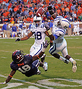 Duke cornerback Leon Wright (7) is defended by Virginia wide receiver Kris Burd (18) during an ACC football game Saturday in Charlottesville, VA. Duke won 28-17. Photo/Andrew Shurtleff