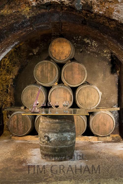 Oak barrels of Rioja wine maturing at Carlos San Pedro Bodega winery in underground cellar of Laguardia, Basque country, Spain