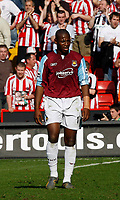 Photo: Paul Greenwood.<br />Sheffield United v West Ham United. The Barclays Premiership. 14/04/2007.<br />Dejection for West Ham's Luis Boa Morte in front of the celebrating Blades fans