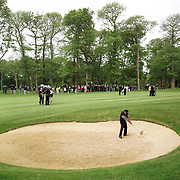 Wales' Ian Woosnam plays out of a bunker on the 18th