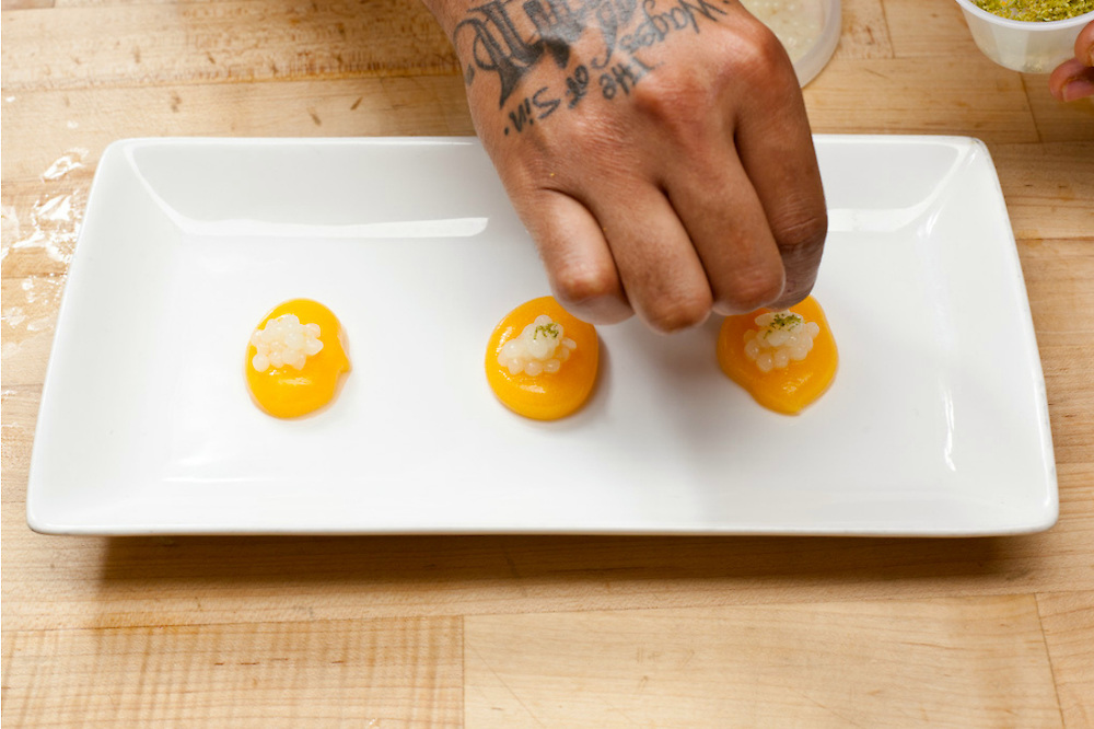 """Marquis Roebuck creates some interesting """"yolks"""" and caviar from orange and lime using tarragon with a technique known as Molecular Gastronomy."""
