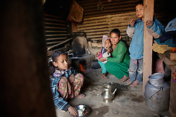 Niruta with her three kids during breakfast inside their temporary home.<br /> <br />  Niruta and Durga were married 9 years ago, when they were just 14 and 16 years old in the Kagati village of Nepal. The 2015 earthquakes devastated Nepal and left girls and women in an increasingly vulnerable position, leading experts to believe child marriage rates will increase over the coming years.