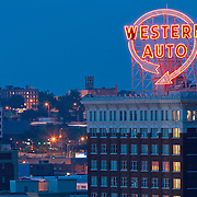 Western Auto sign and Western Auto Lofts at dusk, downtown Kansas City, MO.