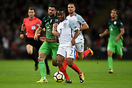 Slovenia's Aljaz Struna  and England midfielder Raheem Sterling during the FIFA World Cup Qualifier match between England and Slovenia at Wembley Stadium, London, England on 5 October 2017. Photo by Martin Cole.
