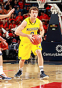 CHARLOTTESVILLE, VA- NOVEMBER 29: Zack Novak #0 of the Michigan Wolverines handles the ball during the game on November 29, 2011 at the John Paul Jones Arena in Charlottesville, Virginia. Virginia defeated Michigan 70-58. (Photo by Andrew Shurtleff/Getty Images) *** Local Caption *** Zack Novak