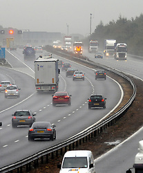 © Licensed to London News Pictures. 13/10/2014<br /> Traffic on the M25 at Junction 3 for Swanley,Kent. Traffic speed has been reduced down to 50mph in Parts..<br /> Heavy rain making dangerous driving conditions on the M25 this morning (13.10.2014) <br /> (Byline:Grant Falvey/LNP)