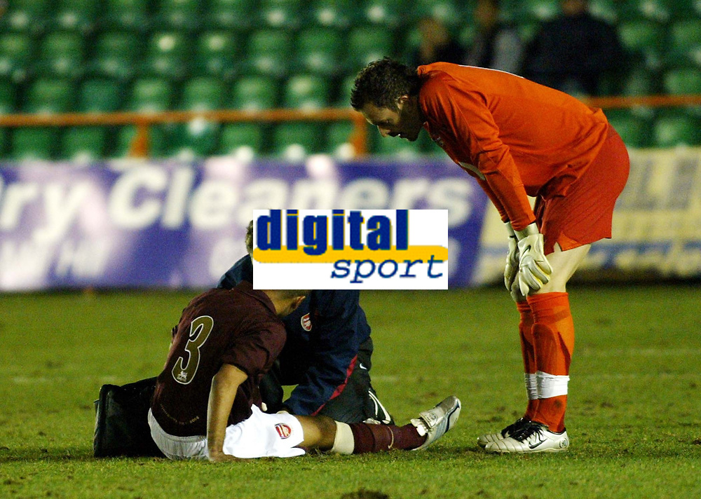 Photo: Chris Ratcliffe.<br /> Arsenal Reserves v Tottenham Hotspurs Reserves. 27/02/2006. <br /> Ashley Cole is injured again less than five minutes into his return for Arsenal reserves, Manuel Almunia looks on.