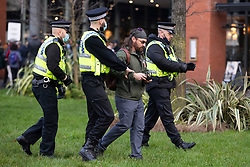 © Licensed to London News Pictures. 06/12/2020. Manchester, UK. A man is pulled aside by police for flying a drone over Piccadilly Gardens during a Rise Up protest in Manchester. Photo credit: Kerry Elsworth/LNP