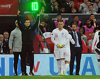 Football - 2018 / 2019 International Friendly - England vs. USA<br /> <br /> Wayne Rooney of England receives the Captain's arm band as he comes on as a 2nd half substitute with Manager Gareth Southgate behind at Wembley Stadium.<br /> <br /> COLORSPORT/ANDREW COWIE