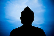 Early morning silhouette of Buddha statue at Borobudor Temple, Central Java, Indonesia.