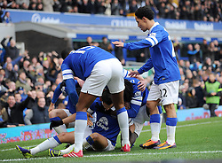 Everton's Kevin Mirallas celebrates with his team mates after scoring. - Photo mandatory by-line: Dougie Allward/JMP - Tel: Mobile: 07966 386802 23/11/2013 - SPORT - Football - Liverpool - Merseyside derby - Goodison Park - Everton v Liverpool - Barclays Premier League
