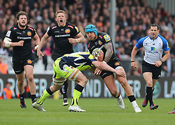 Exeter Chiefs Jack Nowell is tackled by Sale Sharks Tom Curry during the Aviva Premiership match at Sandy Park, Exeter.
