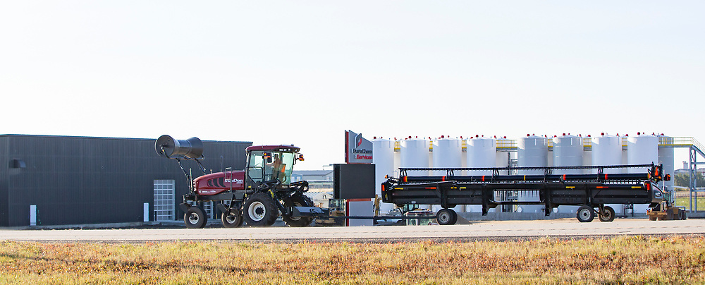 Photo Randy Vanderveen<br /> County of Grande Prairie, Alberta<br /> 2018-09-04<br /> A swather pulling its header with a roller carried on the front makes its way down Highway 43 East near Four Mile Corner Tuesday morning. Motorists on highways and roads in the Peace Country are reminded to be aware of the possibility of meeting up with slower moving agricultural equipment being transported from field to field at this time of year.