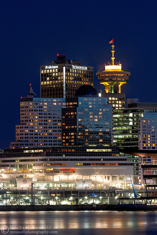 Harbour Center, the Pan Pacific Hotel and other downtown buildings at night in Vancouver, British Columbia, Canada