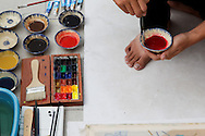 An artist prepares colors for silk painting, an important traditional art form taught in the Fine Arts University of Ho Chi Minh City, Vietnam, Southeast Asia