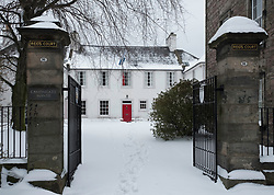 Reid's Court (Canongate Manse) after heavy snow on Royal Mile in Edinburgh Old Town, Scotland, United Kingdom