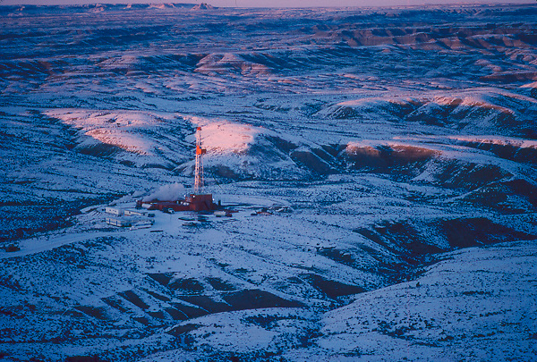 Stock photo of an aerial view of an on-shore rig at a snowy site