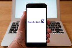 Using iPhone smartphone to display logo of Deutsche Bank