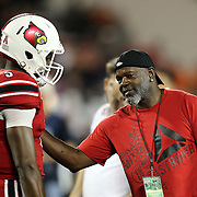 Louisville Cardinals quarterback Teddy Bridgewater (5) is seen speaking with Emmit Smith during warmups prior to the NCAA Football Russell Athletic Bowl football game between the Louisville Cardinals and the Miami Hurricanes, at the Florida Citrus Bowl on Saturday, December 28, 2013 in Orlando, Florida. (AP Photo/Alex Menendez)