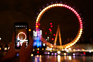 London Eye is illuminated on July 13 night with the colors of the Spanish flag during the Spanish Royals visit UK day 2.