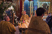 Moscow, Russia, 06/01/2011..Priests with an icon depicting the birth of Christ  as Russian Christians attend an Orthodox Christmas service at Peter Paul church in central Moscow, late on Christmas Eve. Christmas falls on January 7 for Orthodox believers in the Holy Land, Russia and other Orthodox churches that use the old Julian calendar instead of the16th-century Gregorian calendar.