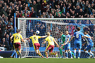 Burnley defender Michael Keane (5) scores to make it 2-2 late in the game during the Sky Bet Championship match between Brighton and Hove Albion and Burnley at the American Express Community Stadium, Brighton and Hove, England on 2 April 2016.