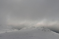 The cloud was fairly low, but where light got through it gave wonderful highlights to the snow-covered rocks