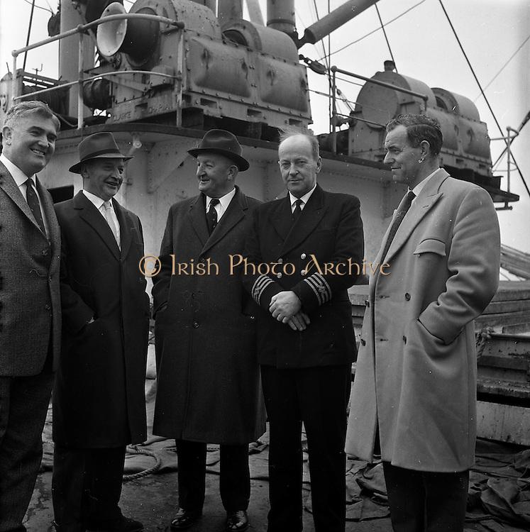 18/04/1962<br /> 04/18/1962<br /> 18 April 1962<br /> Irish sugar for USA<br /> A consignment of 1,600 tons of Irish beet sugar is loaded onto the S.S. Irish ELM at Dublin Docks on Wednesday, 18 April 1962. Left to right: Mr. Con Murphy, P.R.O., Irish Sugar Co.; Mr. J.E. Mac Ellin, chairman, Irish Sugar Co.; Mr. J.J. Stafford, chairman, Irish Shipping Lit.; Capt. F.W. Kirk of the S.S. Irish Elm; and Mr. Liam St. John Devlin, director, Irish Shipping Ltd. on board the S.S. Irish Elm during the loading of the sugar.