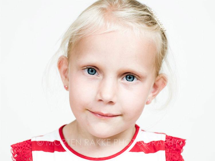 Norway, girl (4-5) smiling, portrait