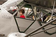 Visitors taking a look at an L-6  at Warbirds Over the West.
