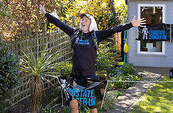 © Licensed to London News Pictures. 05/04/2020. Stoneleigh, UK. Kevin Webber crosses the finishing line after completing the equivalent 32.2Km 1st Stage of the Marathon des Sables ultramarathon in his Surrey garden during lockdown. Kevin, who was diagnosed with terminal prostate cancer just over 5 years ago, was due to take part in his 5th consecutive running of what is described as the 'toughest foot race on Earth' through the Sahara Desert in Southern Morocco this month, but the 2020 six day race has been postponed until September. Kevin will be running the entire 230Km (143 miles) 6 stage race in his small back and front gardens, completing 2734 laps, finishing on Easter Saturday. Kevin is raising funds for the National Emergencies Trust Coronavirus Appeal who will distribute the funds to where they are needed most in the UK and he will jointly split what he raises with Prostate Cancer UK. Photo credit: Peter Macdiarmid/LNP