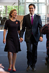 © Licensed to London News Pictures. 02/10/2012. Manchester, UK . Ed Miliband (R) and his wife Justine Thornton (L) arrive for the Labour Leader's speech this (2nd October) afternoon . Labour Party Conference Day 3 at Manchester Central . Photo credit : Joel Goodman/LNP