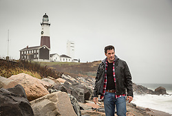 rugged man on a Winter day by the lighthouse in Montauk, NY