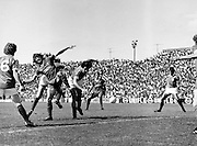 In a pre-season friendly, the League of Ireland took on Liverpool FC at Dalymount Park. The team was made up of players from several League of Ireland clubs and captained by the legendary  <br /> John Giles. Liverpool won the game 2-0. Ray Treacy is on the right of picture, while Liverpool's Terry McDermott (2nd from left) adopts a balletic pose as he attempts to get the ball.<br /> 18/08/1979