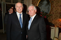 Left to right, IAIN DUNCAN SMITH and SIR NICK LLOYD at a party to celebrate the publication of Right or Wrong: The Memoirs of Lord Bell held at Mark's Club, Charles Street, London on 16th October 2014.