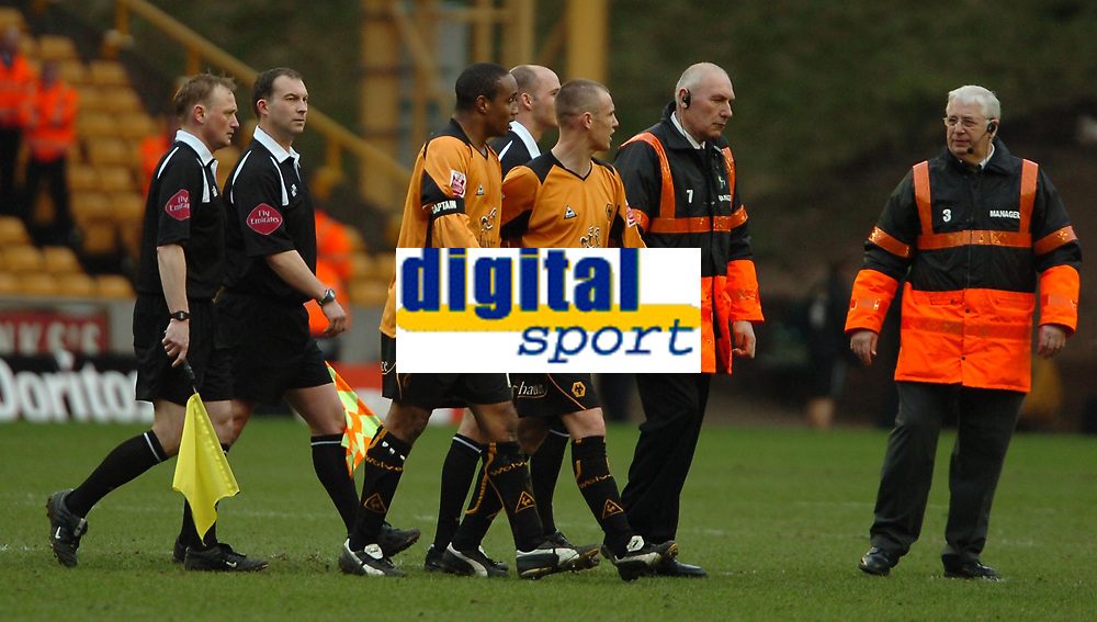 Photo: Ed Godden.<br />Wolverhampton Wanderers v Sheffield Wednesday. Coca Cola Championship. 25/03/2006. <br />Paul Ince leaves the field at half-time after confronting the referee. Pictured with team mate Kenny Miller (R).