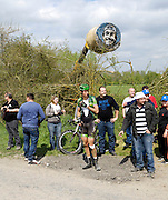 France, April 13th 2014: With a bandaged knee, BJÖRN THURAU, Europcar, waits for his team car at the side of the road as he abandons the race at Pont Gibus, Wallers, following a crash during the Paris Roubaix 2014 cycle race.