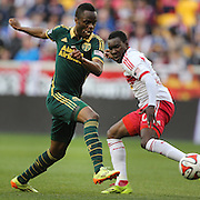 Steve Zakuani, (left), Portland Timbers, dribbles past Lloyd Sam, New York Red Bulls, during the New York Red Bulls Vs Portland Timbers, Major League Soccer regular season match at Red Bull Arena, Harrison, New Jersey. USA. 24th May 2014. Photo Tim Clayton