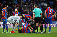 Martin Kelly of Crystal Palace © receives medical treatment on the pitch for an injury. Premier League match, Crystal Palace v Newcastle Uutd at Selhurst Park in London on Sunday 4th February 2018. pic by Steffan Bowen, Andrew Orchard sports photography.