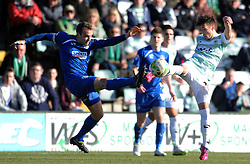 Oldham Athletic's Carl Winchester is tackled by Yeovil Town's Josh Sheenan  - Photo mandatory by-line: Harry Trump/JMP - Mobile: 07966 386802 - 07/03/15 - SPORT - Football - Sky Bet League One - Yeovil Town v Oldham Athletic - Huish Park, Yeovil, England.