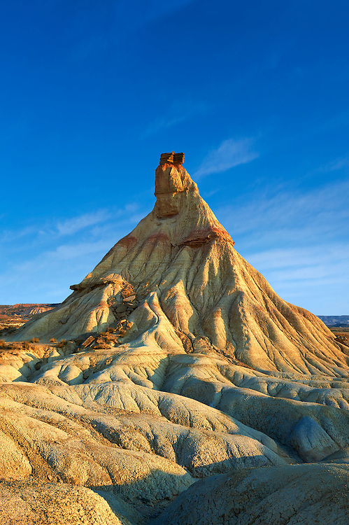 Castildeterra rock formation in the Bardena Blanca area of the Bardenas Riales Natural Park, Navarre, Spain . The Bardenas Reales (sometimes referred as Bárdenas Reales) is a semi-desert natural region, or badlands, of some 42,000 hectares (420 km2; 104,000 acres) in southeast Navarre (Spain). The soils are made up of clay, chalk and sandstone and have been eroded by water and wind creating surprising shapes, canyons, plateaus, tabular structures and isolated hills, called cabezos. Bardenas Reales lacks urban areas, vegetation is scarce and the many streams that cross the territory have a markedly seasonal flow, staying dry most of the year.<br /> <br /> Visit our SPAIN HISTORIC PLACES PHOTO COLLECTIONS for more photos to download or buy as wall art prints https://funkystock.photoshelter.com/gallery-collection/Pictures-Images-of-Spain-Spanish-Historical-Archaeology-Sites-Museum-Antiquities/C0000EUVhLC3Nbgw