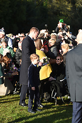 The Duke of Cambridge and Prince George meet well wishers after attending the Christmas Day morning church service at St Mary Magdalene Church in Sandringham, Norfolk.