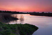 Spring sunset over the River Parrett near Bridgwater. Taken the first night after a volcanic eruption in Iceland, which expelled large quantities of ash into the sky. The setting sun shows the volcanic ash from the Eyjafjallajokull eruption in April 2010.