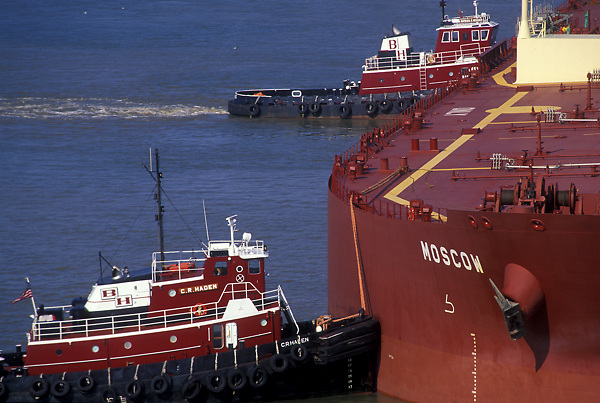 Aerial view of the tanker Moscow being secured by tugboats