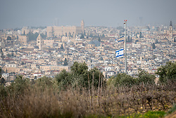 25 February 2020, Jerusalem: Israeli flags wave by the Beit Ottorot settlement on the Mount of Olives.
